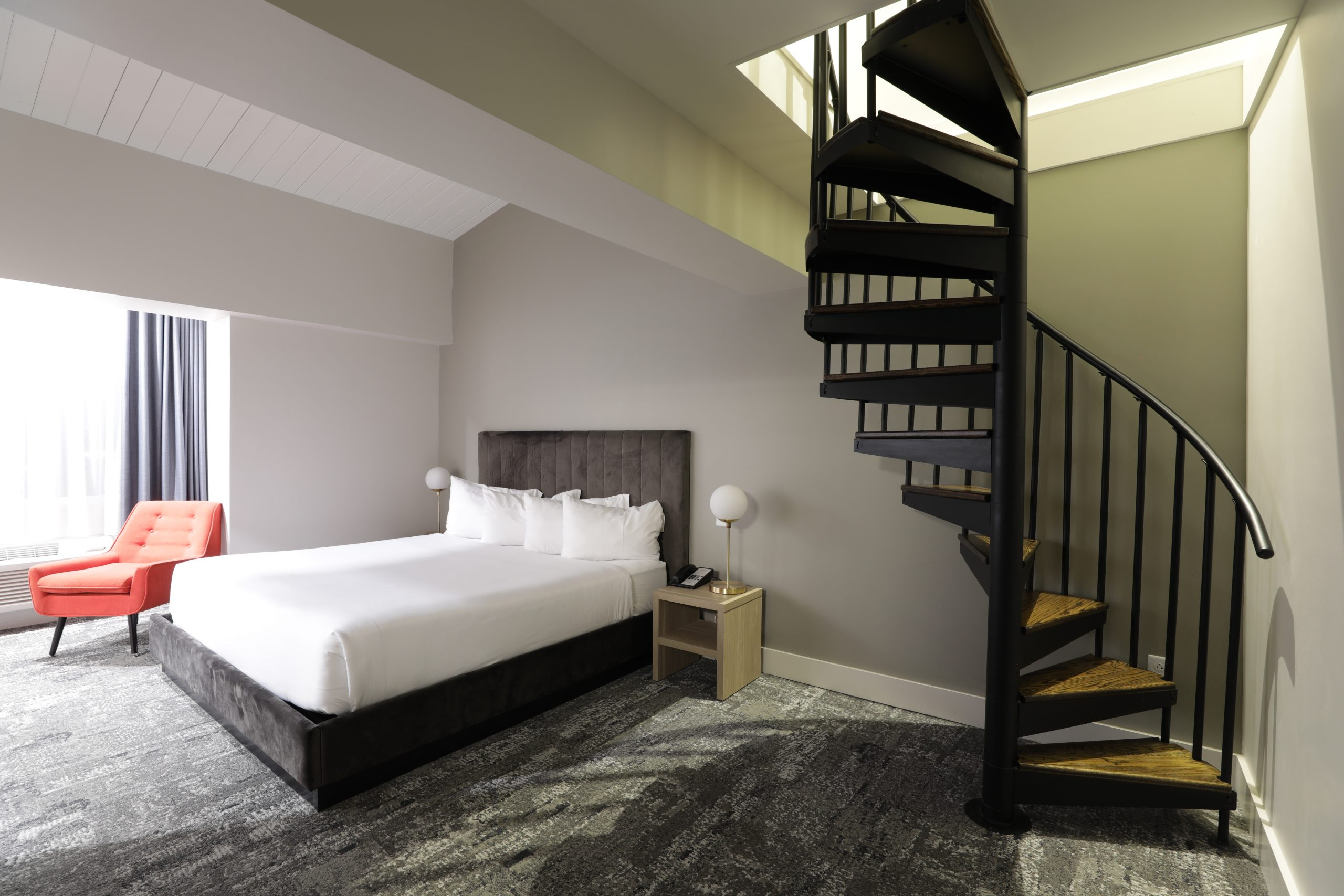 King Loft Suite with spiral staircase to loft