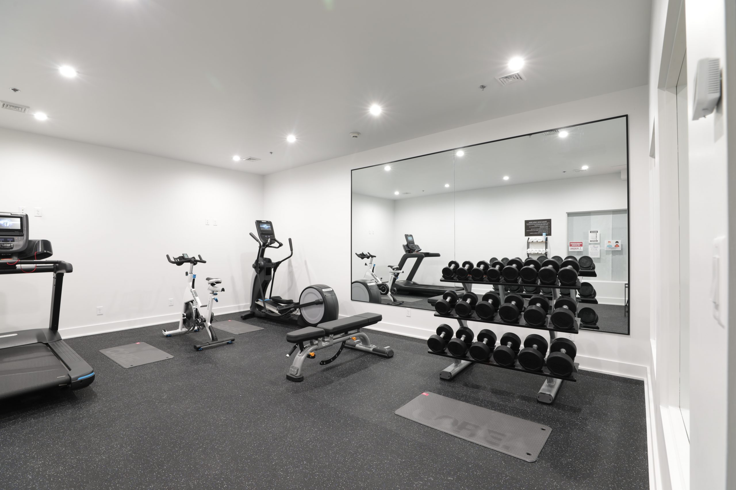 Furnished exercise room at the Boutique Hotel