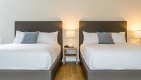 2 queen beds in the Main Street Suite
