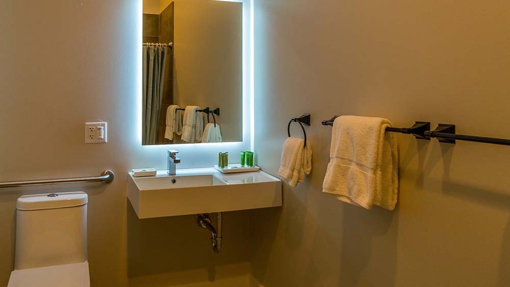 Bathroom with backlit mirror