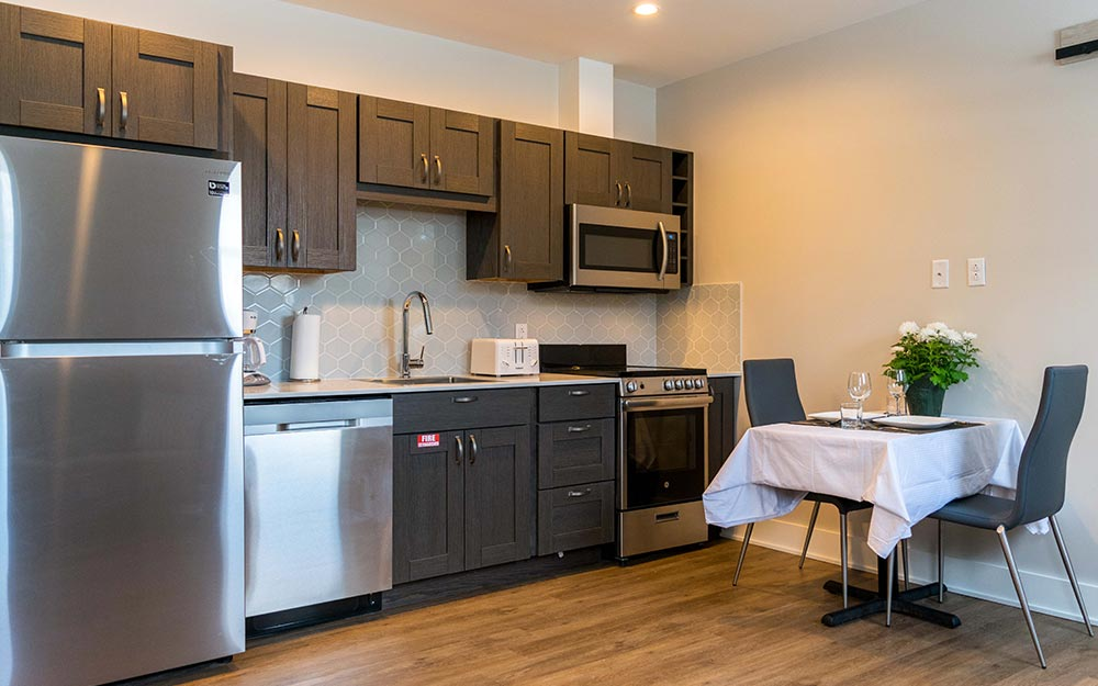 Kitchen with small table with 2 chairs