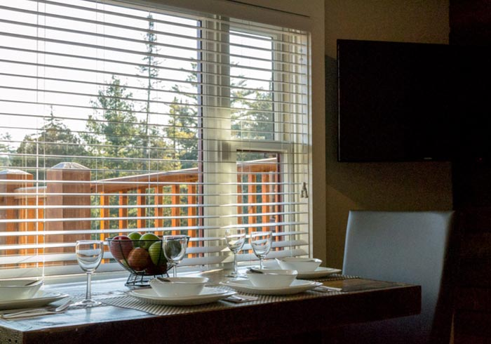 Dining table next to large window