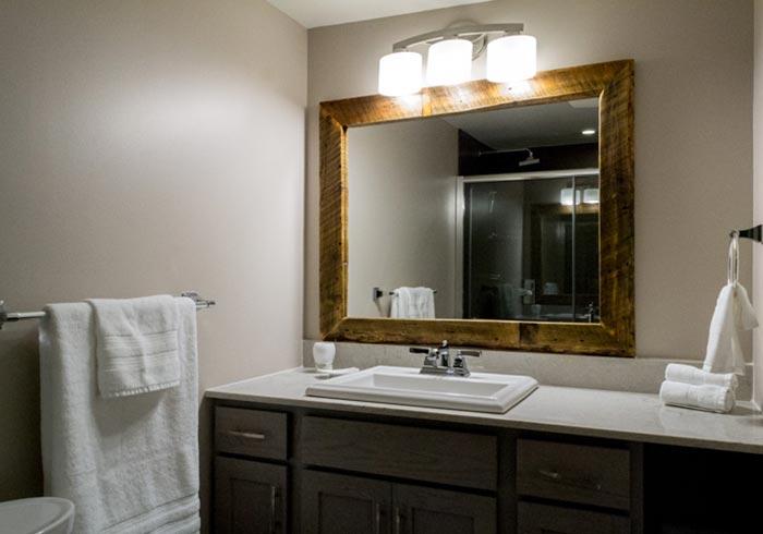 Bathroom with vanity and rustic wood mirror