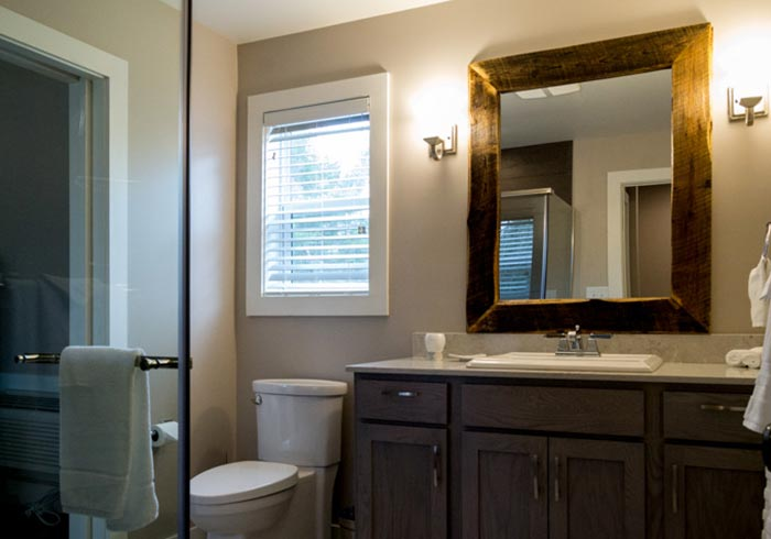 Bathroom with vanity and rustic mirror