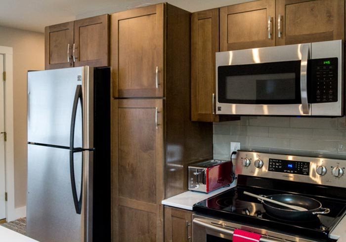 Kitchen with wood cabinets and stainless steel appliances