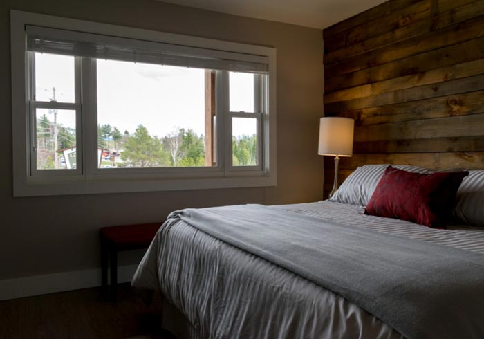 Bedroom with large bed and window