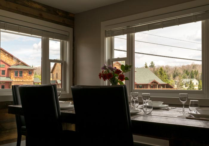 Large dining table looking out of two windows