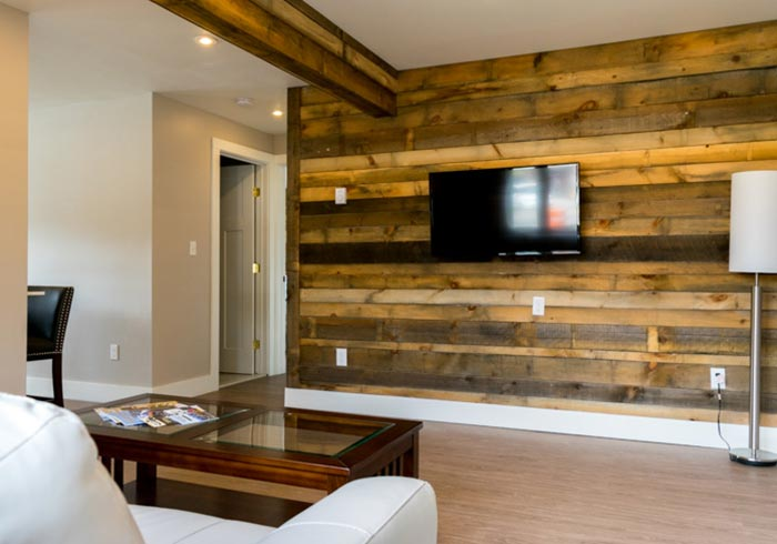 Wood paneled wall with mounted TV