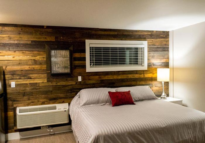 Bed with barn wood wall with window