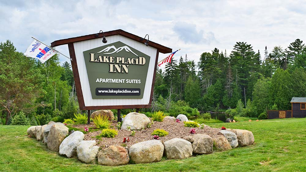 Lake Placid Inn Sign with landscaping
