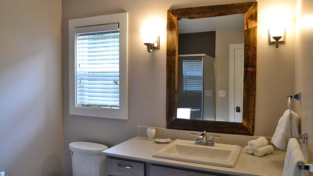 Bathroom with rustic mirror