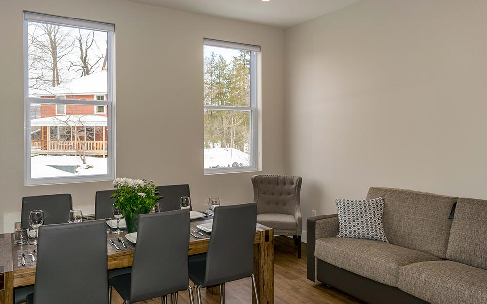 Dining area with small couch and chair in corner